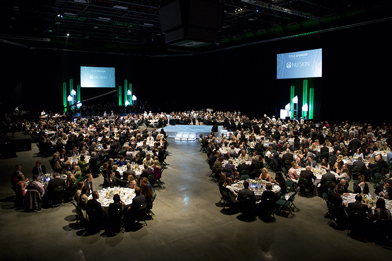 Overhead shot of the UCCU Center filled with guests at tables and decorated for the Scholarship Ball.